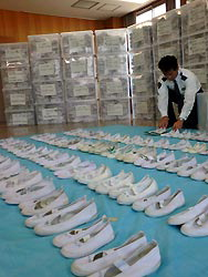 lotofshoes Man steals 5,000 shoes to savor the smell picture