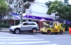Chinese Woman Pulls Crazy Stunt to Avoid Being Impounded: