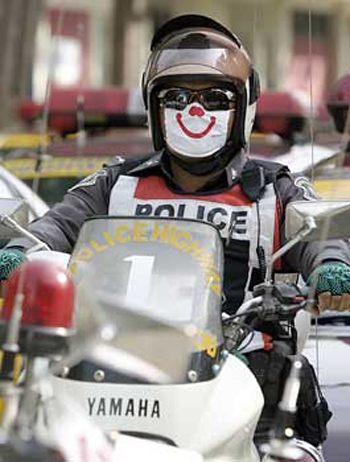 Thailand Police Don Smiley Masks: Ha, Ha… Wha?