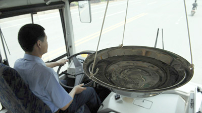 Water Slows Down Chinese Bus Drivers picture