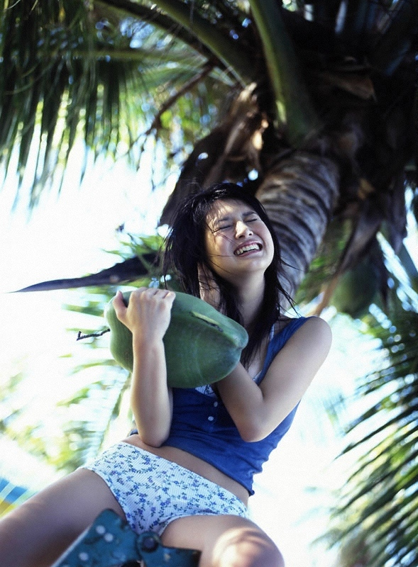 Aimi in blue top holding a coconut