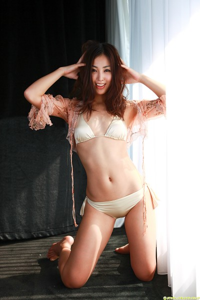 Minase in off-white lingerie hands on head