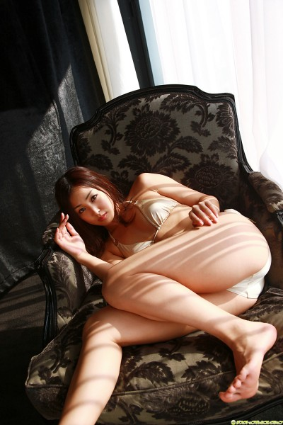 Minase in off-white lingerie on the chair