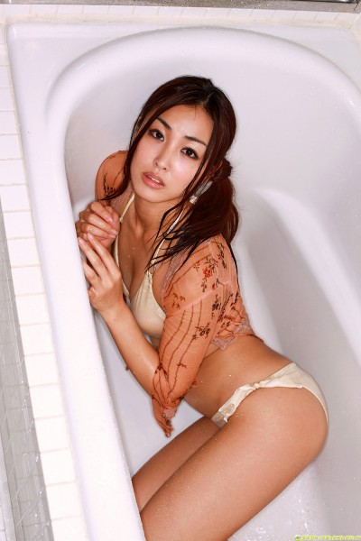 Minase in off-white lingerie on the tub
