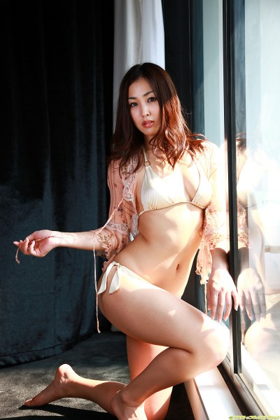 Minase in off-white lingerie pressing against the glass window