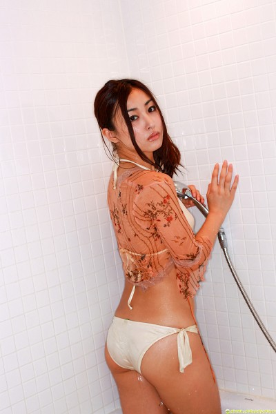 Minase in off-white lingerie side turn
