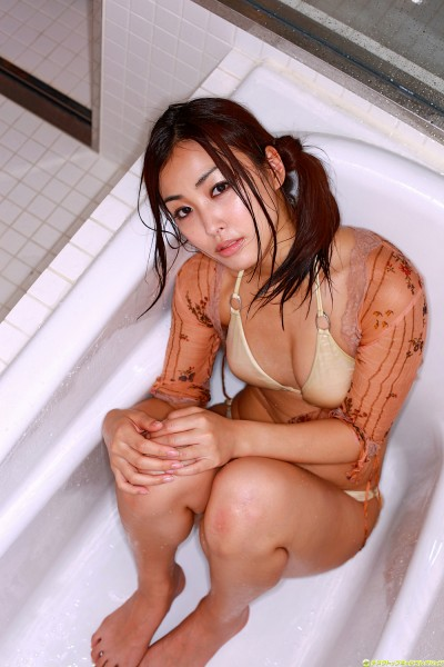 Minase in off-white lingerie sitting on the bath tub