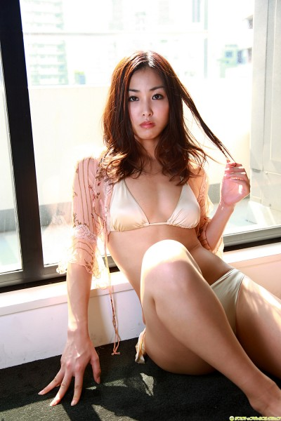 Minase in off-white lingerie touching her hair