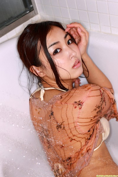 Minase in off-white lingerie washing her back