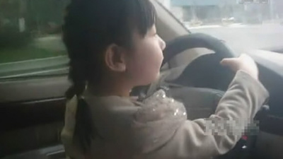 Parents Allow Four year old Child to Drive Car picture
