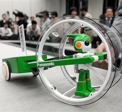 green evolta Toy Robot Prepares For Ironman Triathlon picture