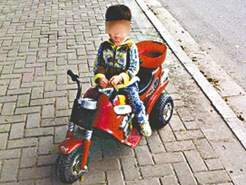 3 year old Boy Rides 3 Miles Down Busy Streets picture