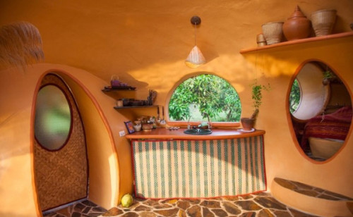 Former Flight Attendant Builds Modern Hobbit like House  picture