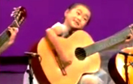 North Korea Shows Off Its Musical Talent: Kids with Adult Sized Guitars picture