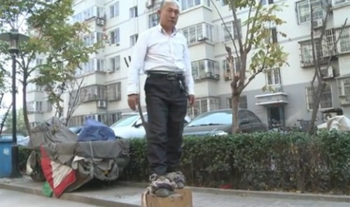 Chinese Iron Man Flaunts His Iron Shoes picture