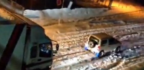 Compact SUV Rescues Large Truck, Tows Through Snow picture