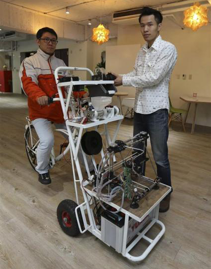 3 D Printer on Bicycle Turns Waste into Works of Art picture