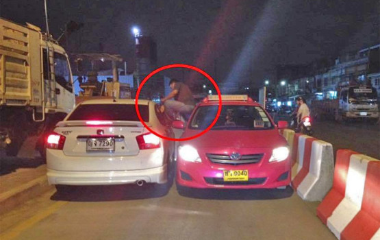 Taxi Driver Kicks Motorist Through Car Window