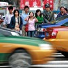 Pedestrians in China waiting to cross the street