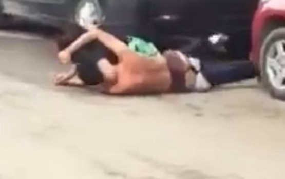 Naked Couple Wrestles in Street