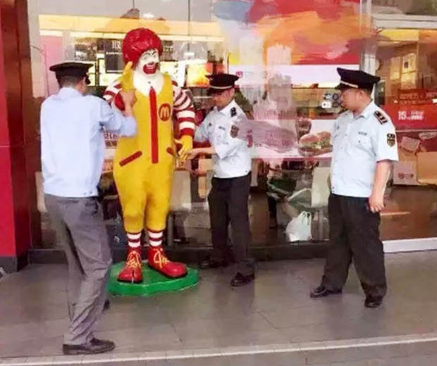 Breaking Up Is Hard To Do Police Officer Charged With: Ronald McDonald Sculpture Arrested In China